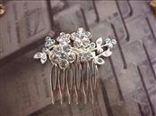 "SILVERTONE HAIR COMB - 1-1/4"" WIDE COMB - 2-1/4"" WIDE BLING.  LIGHT BLUE JEWELS."
